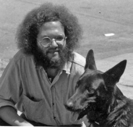 Black-and-white image of Stuart with his dog Blue